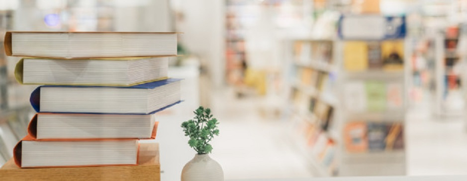 book-stack-library-room-blurred-bookshelf-background_42691-514